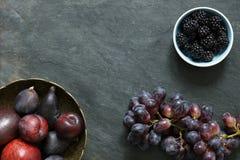Dark Exotic Fruits on slate background Royalty Free Stock Photography