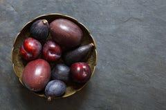 Dark Exotic Fruits on slate background Stock Photography