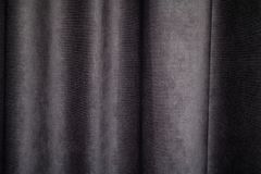 Dark fabric creasy textile surface texture. High quality, dark fabric creasy textile surface texture in good condition royalty free stock photography