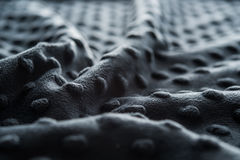 Dark fabric with dots close up background Royalty Free Stock Images