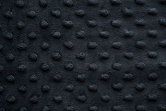 Dark fabric with dots close up background Royalty Free Stock Image