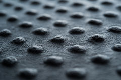 Dark fabric with dots close up background Royalty Free Stock Photography
