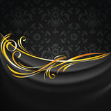 Dark fabric drapes on black ornamental background stock photography