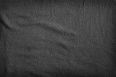 Dark fabric texture. Stock Photos