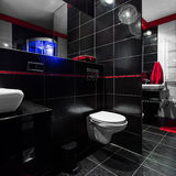 Dark and fancy bathroom. Interior of a stylish, dark and fancy bathroom Stock Image