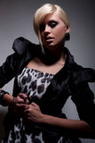 Dark fashion blond girl. Dark atelier scene Stock Photo
