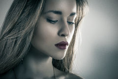 Dark fashion portrait of a beautiful young girl stock photos