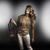 Dark fashion style with fashionable bag accessory Royalty Free Stock Image