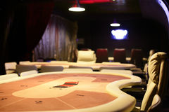 Dark and fashionable casino with tables Stock Images