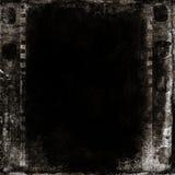 Dark film strips. Grunge background with film strips Royalty Free Stock Photos