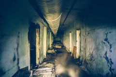 Dark flooded corridor or tunnel in old underground abandoned Soviet military bunker. Dark toned stock photo