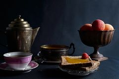 Cup of tea, toats, fresh apricots and homemade apricot jam. royalty free stock photography