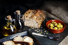 Dark Food - Fresh pumpkin seed bread with olives Stock Photos