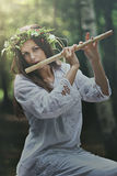 Dark forest nymph with a flute Stock Photos