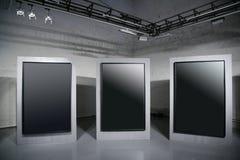 Dark frames. Three big dark frames at hall Royalty Free Stock Photos