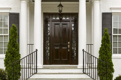 Dark front door with white columns stock photography