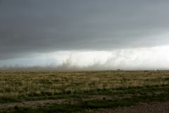 Dark funnel cloud of moisture laden rotating air royalty free stock image