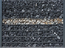 Dark gabion with a bright stripe Royalty Free Stock Photo
