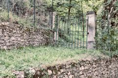 Dark gate. In a isolated tuscany campaign Stock Photography