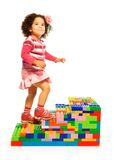 Dark girl climbing on toy ladder Stock Photos