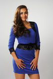 The dark girl with curly hair in a blue dress Royalty Free Stock Image