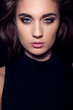 Dark girl portrait with blue eyes Royalty Free Stock Photography