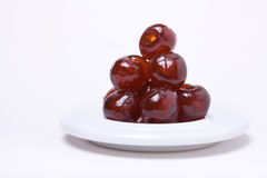 Dark Glace Cherry Tower. A tower of pitted dark glossy Morello Glace cherries against white background Royalty Free Stock Photo