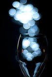 Dark and glass. Capturing the moment with a glass Royalty Free Stock Image