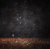 Dark glitter vintage lights background. light gold and black. defocused
