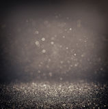 Dark glitter vintage lights background. light silver and black. defocused. Stock Images