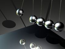 Dark Globes Pendulum Stock Photo