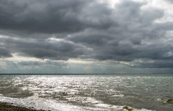 Dark gloomy day on a Uk beach Stock Images