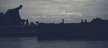 Dark and gloomy effect on the shipwrecks at Tangalooma Island. Shipwrecks at Tangalooma Island in Moreton Bay with a dark and gloomy effect Royalty Free Stock Photos