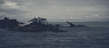 Dark and gloomy effect on the shipwrecks at Tangalooma Island. Shipwrecks at Tangalooma Island in Moreton Bay with a dark and gloomy effect Royalty Free Stock Photography