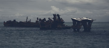 Dark and gloomy effect on the shipwrecks at Tangalooma Island. Shipwrecks at Tangalooma Island in Moreton Bay with a dark and gloomy effect Stock Photo