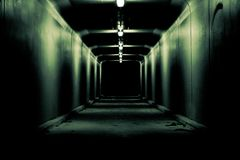 Creepy dark tunnel to nowhere stock images