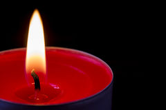 Dark glowing red tea light Royalty Free Stock Photos