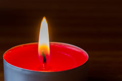 Dark glowing red tea light Stock Photos