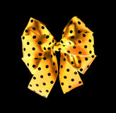 Dark gold bow on black Royalty Free Stock Images