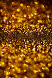 Dark Gold Festive blur background. Abstract night twinkled bri Royalty Free Stock Photography