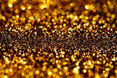 Dark Gold Festive blur background. Abstract night twinkled bri Royalty Free Stock Image