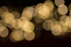 Dark Gold Festive blur background. Royalty Free Stock Photos