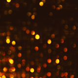 Dark Gold  Festive Christmas background. Elegant abstract background with bokeh defocused lights and stars Royalty Free Stock Image
