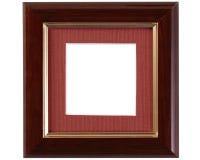 Dark gold-rimmed wooden frame Stock Photography