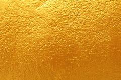 Dark golden cement texture background. Bright golden surface for the background Royalty Free Stock Image
