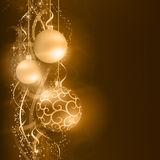Dark golden Christmas background with hanging Christmas balls. Border with golden, desaturated Christmas balls hanging over a golden wavy pattern with stars and Royalty Free Stock Photography