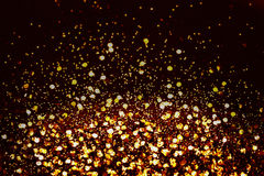 Dark golden  colored glitter abstract background Royalty Free Stock Photos
