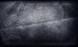 Dark gothic texture of the old paper sheet. Black cardboard grunge background. Royalty Free Stock Image