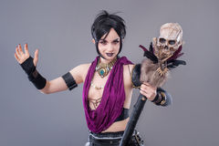 Dark gothic woman. Gothic woman posing with skull royalty free stock photos