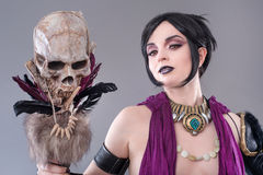 Dark gothic woman. Gothic woman posing with skull stock images